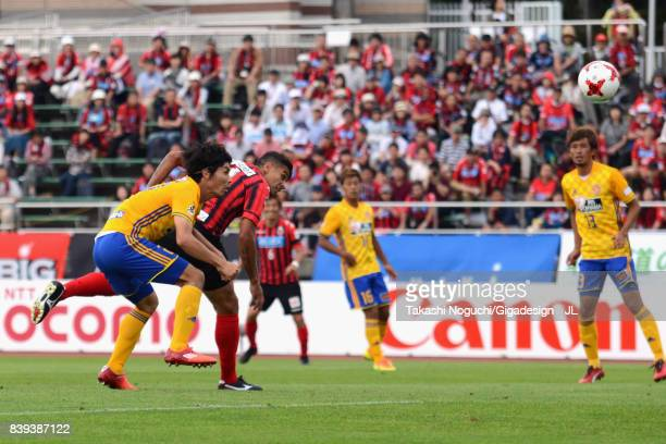 Reis of Consadole Sapporo heads the ball to score the opening goal during the JLeague J1 match between Consadole Sapporo and Vegalta Sendai at...
