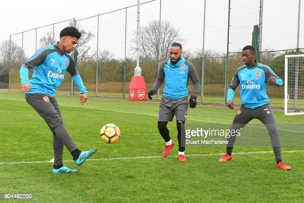 Reiss Nelson Alex Lacazette and Eddie Nketiah of Arsenal during a training session at London Colney on January 13 2018 in St Albans England