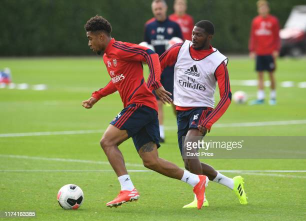 Reiss Nelson and Ainsley Maitland-Niles of Arsenal during the Arsenal Training Session at London Colney on September 12, 2019 in St Albans, England.