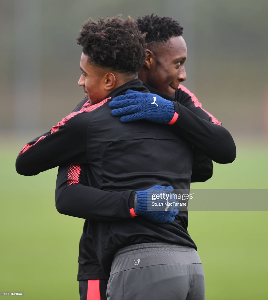 Reiss Nelson and Danny Welbeck of Arsenal during a training session at London Colney on February 21, 2018 in St Albans, England.