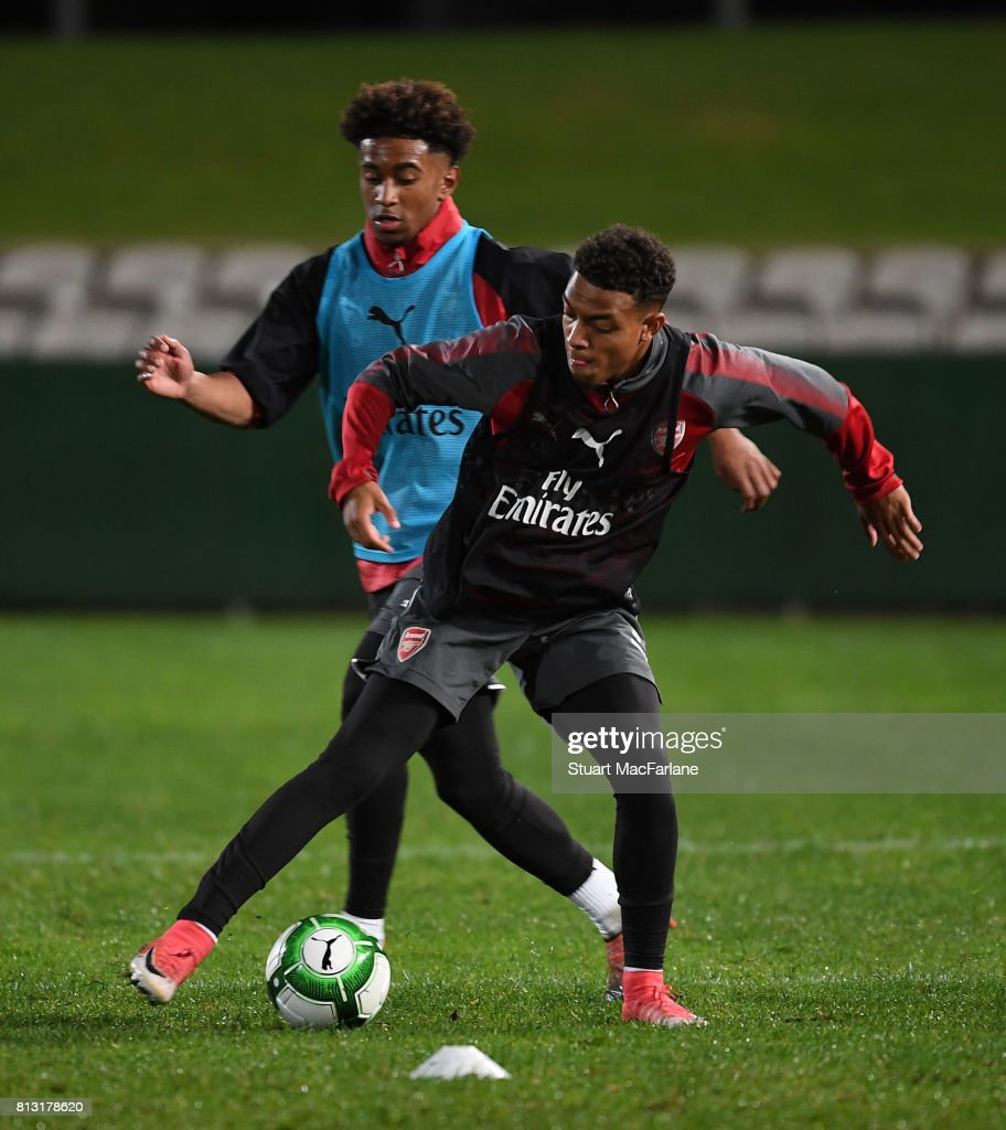 Reiss Nelson and Dnoyell Maylen of Arsenal during a training session at the Koraragh Oval on July 12, 2017 in Sydney, New South Wales.