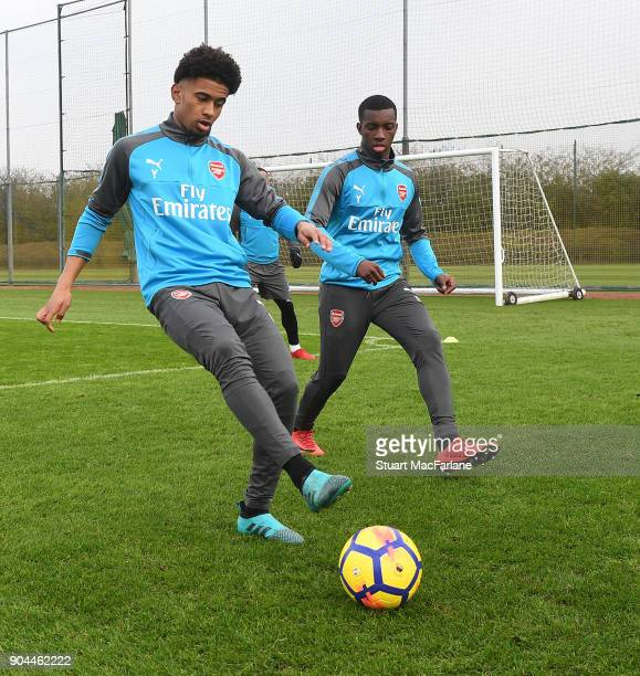 Reiss Nelson and Eddie Nketiah of Arsenal during a training session at London Colney on January 13 2018 in St Albans England