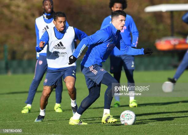 Reiss Nelson and Granit Xhaka of Arsenal during a training session at London Colney on January 22, 2021 in St Albans, England.