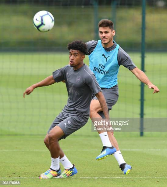 Reiss Nelson and Konstantinos Mavropanosof Arsenal during a training session at London Colney on July 10 2018 in St Albans England