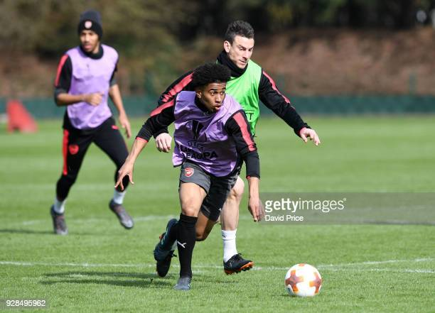 Reiss Nelson and Laurent Koscielny of Arsenal during the Arsenal Training Session at London Colney on March 7 2018 in St Albans England