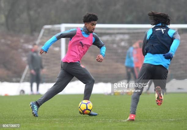 Reiss Nelson and Mohamed Elneny of Arsenal during a training session at London Colney on March 3 2018 in St Albans England