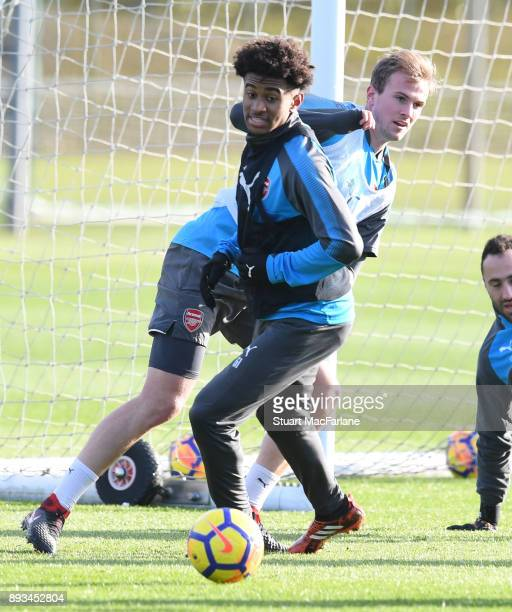 Reiss Nelson and Rob Holding of Arsenal during a training session at London Colney on December 15 2017 in St Albans England