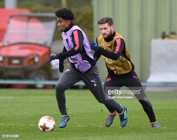 Reiss Nelson and Shkodran Mustafi of Arsenal during a training session at London Colney on February 14 2018 in St Albans United Kingdom