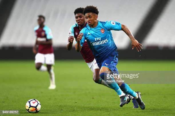 Reiss Nelson Arsenal battles for possesion with Ben Johnson of West Hamduring the Premier League 2 match between West Ham United and Arsenal at...