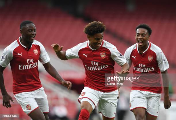 Reiss Nelson celebrates scoring a goal for Arsenal with Josh Dasilva and Joe Willock during the match between Arsenal U23 and Manchester City U23 at...