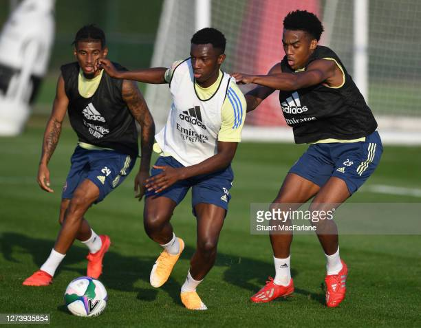Reiss Nelson, Eddie Nketiah and Joe Willock of Arsenal during a training session at London Colney on September 21, 2020 in St Albans, England.