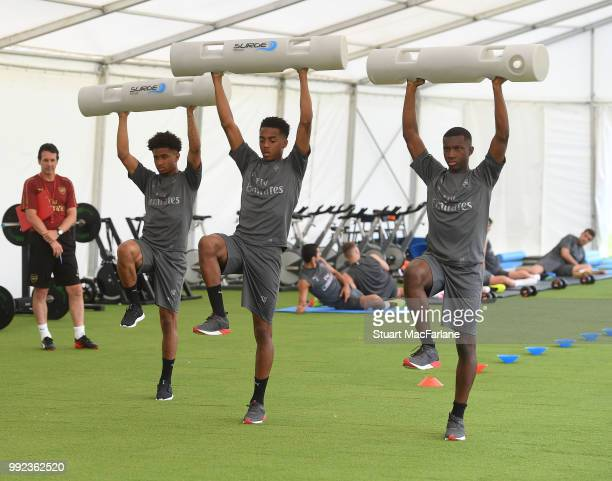 Reiss Nelson Joe Willock and Eddie Nketiah of Arsenal during a training session at London Colney on July 5 2018 in St Albans England