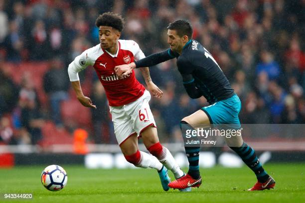 Reiss Nelson of Arsenal and Dusan Tadic of Southampton battle for possession during the Premier League match between Arsenal and Southampton at...