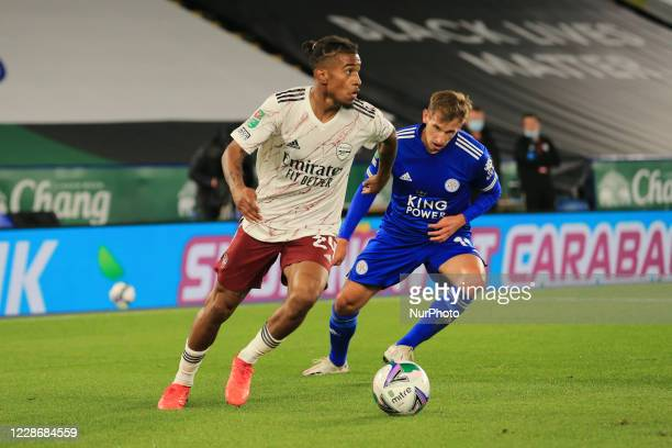 Reiss Nelson of Arsenal and Marc Albrighton of Leicester City during the Carabao Cup match between Leicester City and Arsenal at the King Power...