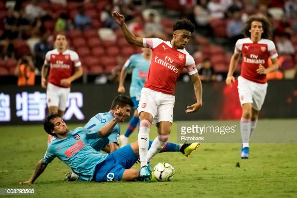 Reiss Nelson of Arsenal battles for the ball against Roberto Olabe of Club Atletico de Madrid during the International Champions Cup 2018 match...