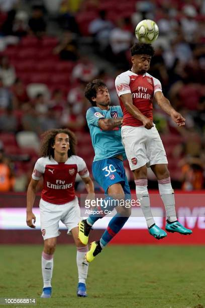 Reiss Nelson of Arsenal battles Roberto Olabe of Atletico Madrid during the International Champions Cup 2018 match between Club Atletico de Madrid...