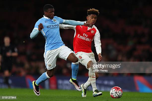 Reiss Nelson of Arsenal battles with Javairo Dilrosun of Man City during the FA Youth Cup semifinal second leg match between Arsenal and Manchester...
