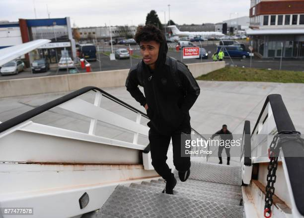 Reiss Nelson of Arsenal boards the plane at Luton Airport on November 22 2017 in Luton England