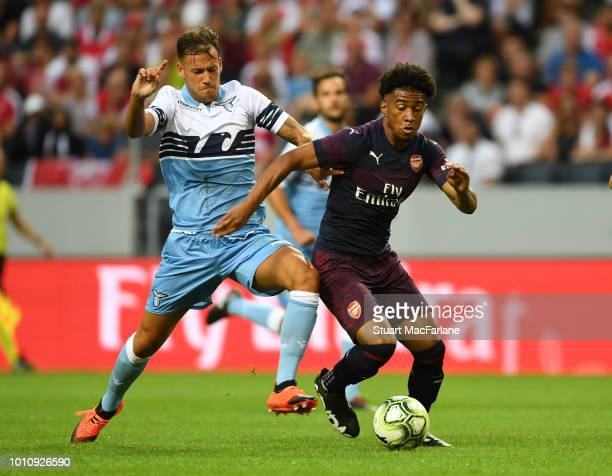 Reiss Nelson of Arsenal breaks past Alessandro Murgia of Lazio during the Preseason friendly between Arsenal and SS Lazio on August 4 2018 in...