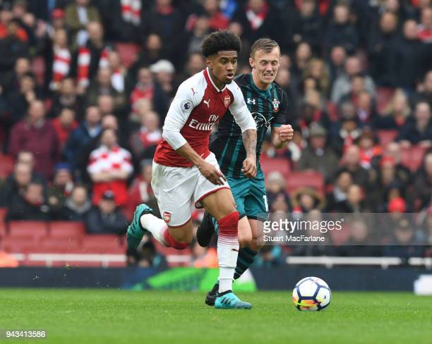 Reiss Nelson of Arsenal breaks past James WardProwse of Southampton during the Premier League match between Arsenal and Southampton at Emirates...