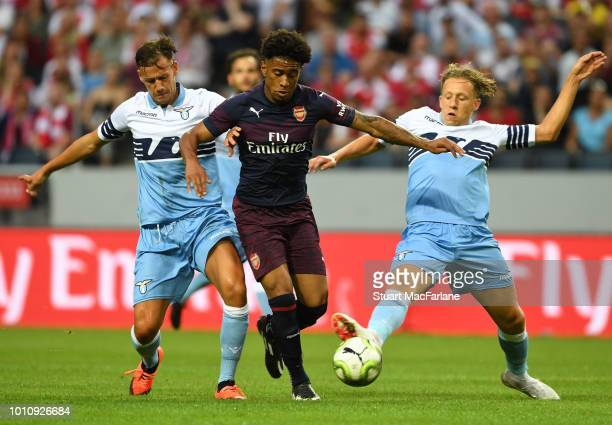 Reiss Nelson of Arsenal breaks past L_ Alessandro Murgia and Lucas Leica of Lazio during the Preseason friendly between Arsenal and SS Lazio on...