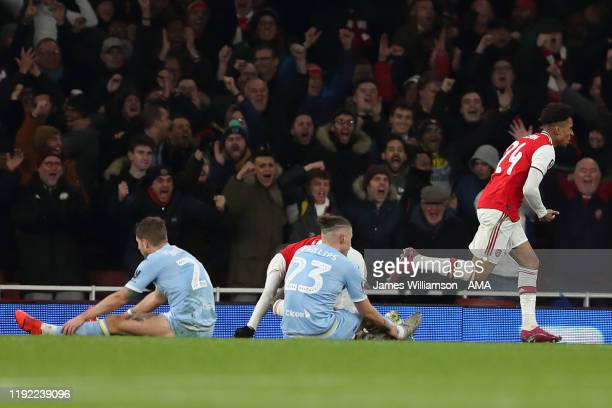 Reiss Nelson of Arsenal celebrates after scoring a goal to make it 1-0 during the FA Cup Third Round match between Arsenal and Leeds United at...