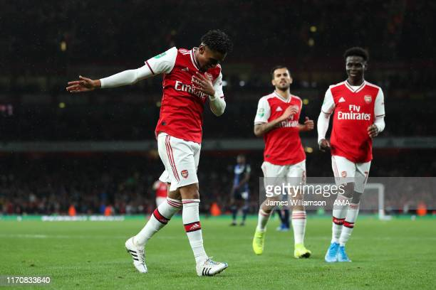 Reiss Nelson of Arsenal celebrates after scoring a goal to make it 4-0 during the Carabao Cup Third Round match between Arsenal and Nottingham Forest...