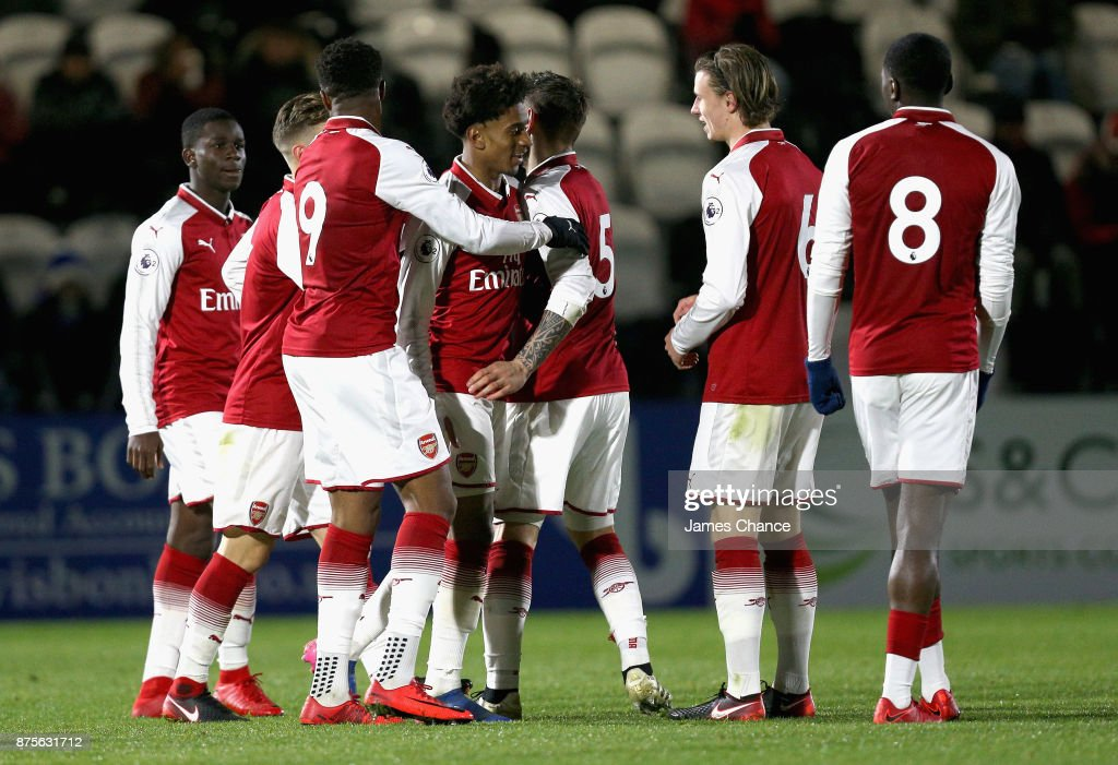 Reiss Nelson of Arsenal celebrates scoring his sides first goal with his Arsenal team mates during the Premier League International Cup match between Arsenal and Porto at Meadow Park on November 17, 2017 in Borehamwood, England.