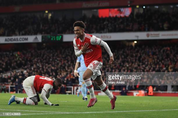 Reiss Nelson of Arsenal celebrates scoring the opening goal during the FA Cup Third Round match between Arsenal and Leeds United at Emirates Stadium...