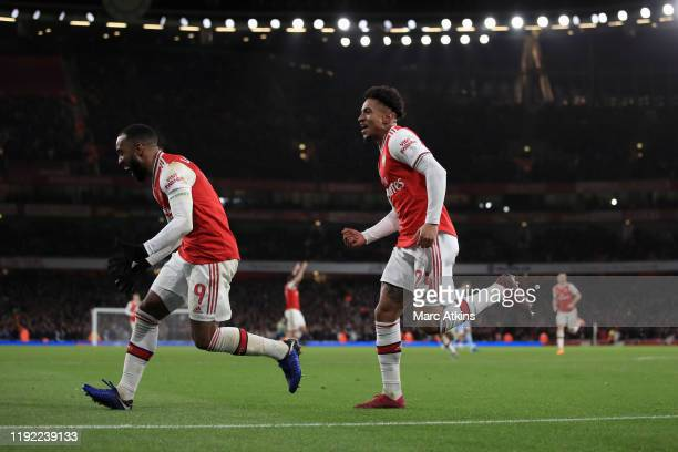 Reiss Nelson of Arsenal celebrates scoring the opening goal with Alexandre Lacazette during the FA Cup Third Round match between Arsenal and Leeds...