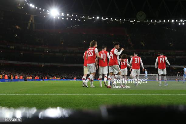 Reiss Nelson of Arsenal celebrates scoring the opening goal with team mates during the FA Cup Third Round match between Arsenal and Leeds United at...