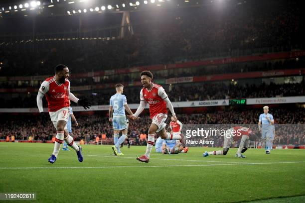 Reiss Nelson of Arsenal celebrates with Alexandre Lacazette during the FA Cup Third Round match between Arsenal and Leeds United at Emirates Stadium...