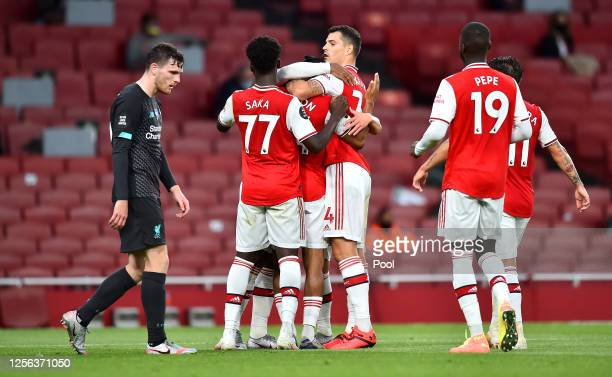 Reiss Nelson of Arsenal celebrates with teammates after scoring his sides second goal during the Premier League match between Arsenal FC and...