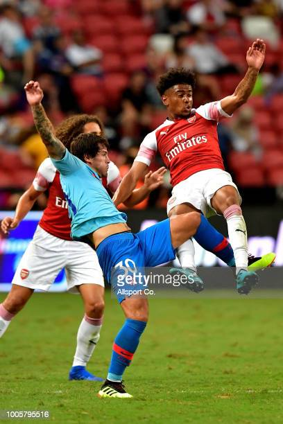 Reiss Nelson of Arsenal clashes with Roberto Olabe of Atletico Madrid during the International Champions Cup 2018 match between Club Atletico de...