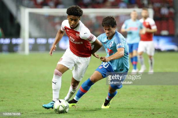 Reiss Nelson of Arsenal dribbles past Roberto Olabe of Atletico Madrid during the International Champions Cup 2018 match between Atletico Madrid and...