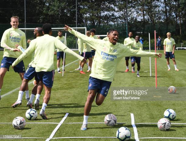Reiss Nelson of Arsenal gestures during a training session at London Colney on July 11, 2020 in St Albans, England.