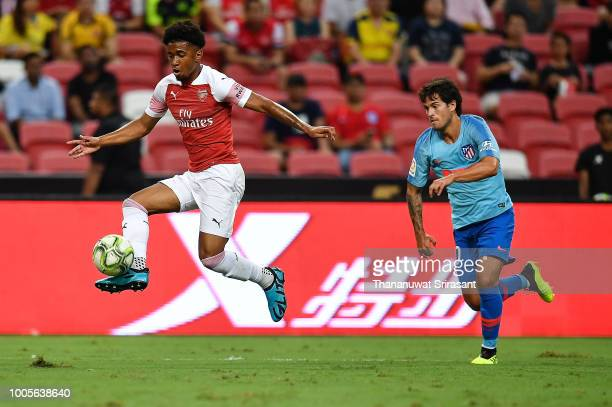 Reiss Nelson of Arsenal holds the ball during the International Champions Cup 2018 match between Club Atletico de Madrid and Arsenal at the National...