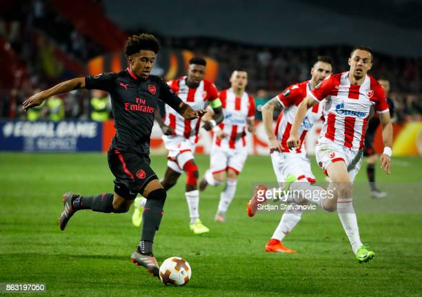 Reiss Nelson of Arsenal in action against Milan Rodic of Crvena Zvezda during the UEFA Europa League group H match between Crvena Zvezda and Arsenal...