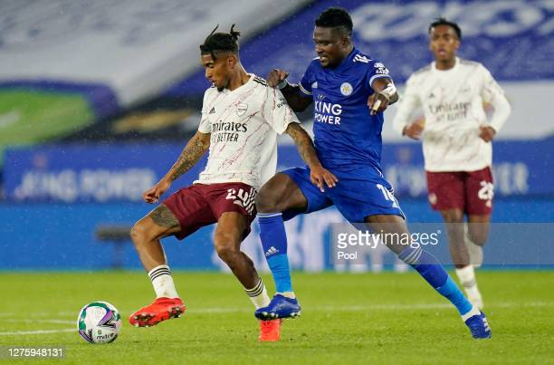 Reiss Nelson of Arsenal is challenged by Daniel Amartey of Leicester City during the Carabao Cup third round match between Leicester City and Arsenal...