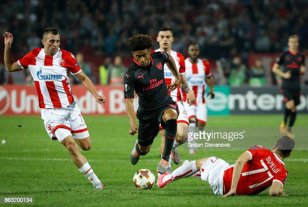 Reiss Nelson of Arsenal is challenged by Marko Gobeljic of Crvena Zvezda during the UEFA Europa League group H match between Crvena Zvezda and...