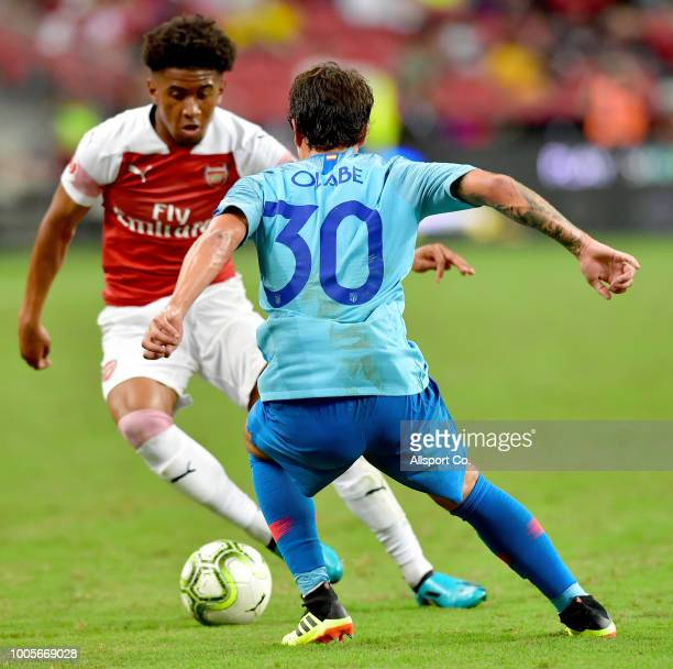 Reiss Nelson of Arsenal is checked by Roberto Olabe of Atletico Madrid during the International Champions Cup 2018 match between Club Atletico de...