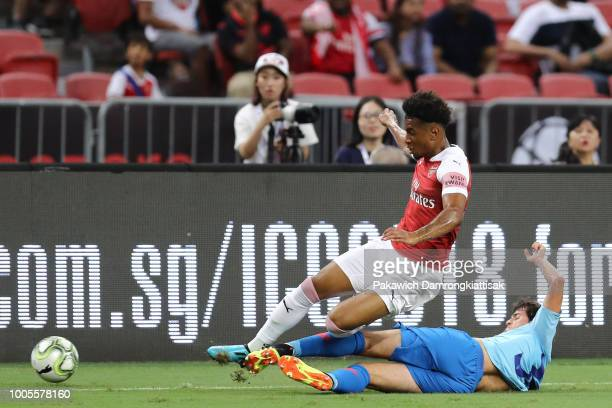 Reiss Nelson of Arsenal is tackled by Roberto Olabe of Club Atletico de Madrid during the International Champions Cup 2018 match between Club...