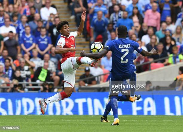 Reiss Nelson of Arsenal knocks the ball past Antonio Rudiger of Chelsea during the match between Chelsea and Arsenal at Wembley Stadium on August 6...
