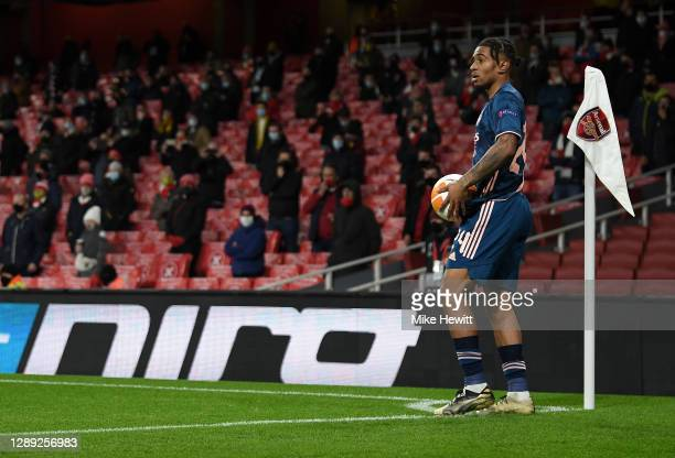 Reiss Nelson of Arsenal prepares to take a corner kick as fans look on while social distancing in in the stands during the UEFA Europa League Group B...