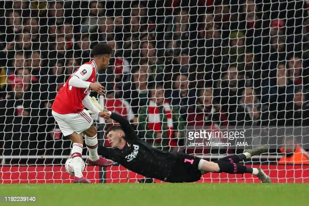 Reiss Nelson of Arsenal scores a goal to make it 1-0 during the FA Cup Third Round match between Arsenal and Leeds United at Emirates Stadium on...