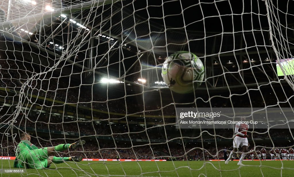 Reiss Nelson of Arsenal scores from the penalty spot during the International Champions Cup 2018 match between Arsenal and Chelsea at the Aviva Stadium on August 1, 2018 in Dublin, Ireland.