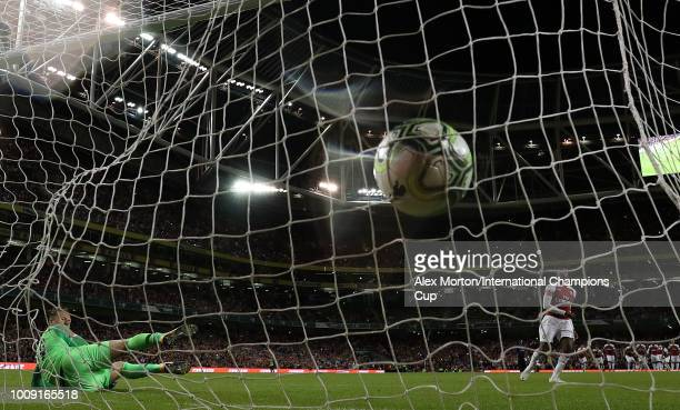 Reiss Nelson of Arsenal scores from the penalty spot during the International Champions Cup 2018 match between Arsenal and Chelsea at the Aviva...