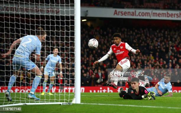Reiss Nelson of Arsenal scores his side's first goal during the FA Cup Third Round match between Arsenal FC and Leeds United at the Emirates Stadium...
