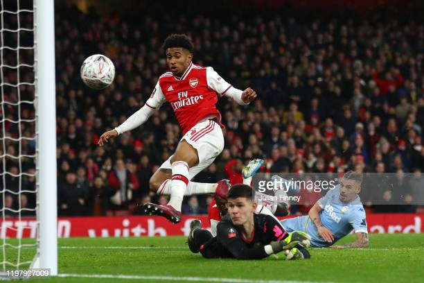 Reiss Nelson of Arsenal scores his side's first goal past Illan Meslier of Leeds United during the FA Cup Third Round match between Arsenal FC and...