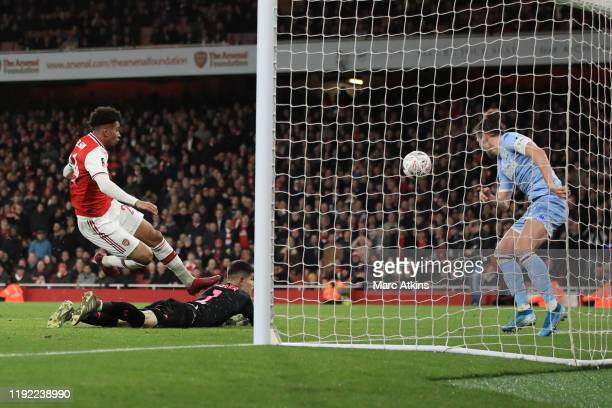 Reiss Nelson of Arsenal scores the opening goal during the FA Cup Third Round match between Arsenal and Leeds United at Emirates Stadium on January...